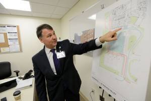 "Mark Sparta, CEO of HackensackUMC at Pascack Valley, with the plans for the hospital's new emergency department, which he called the ""front door"" of any hospital."